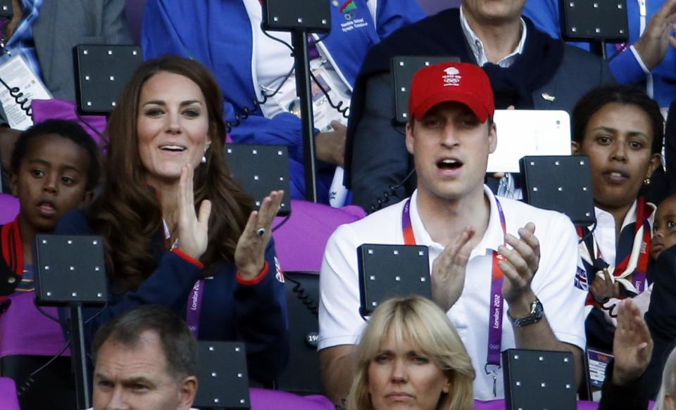 From left, Catherine, the Duchess of Cambridge, and Prince William, the Duke of Cambridge, watche athletics competition in the Olympic Stadium at the 2012 Summer Olympics, Saturday, Aug. 4, 2012 in London. AP Photo/Matt Dunham)