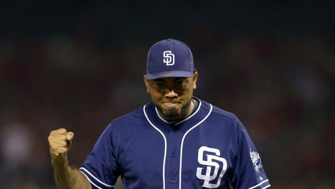 San Diego Padres relief pitcher Joaquin Benoit pumps his fist after getting St. Louis Cardinals' Kolten Wong to fly out to end the eighth inning of a baseball game Friday, July 3, 2015, in St. Louis. The Padres won 2-1. (AP Photo/Jeff Roberson)