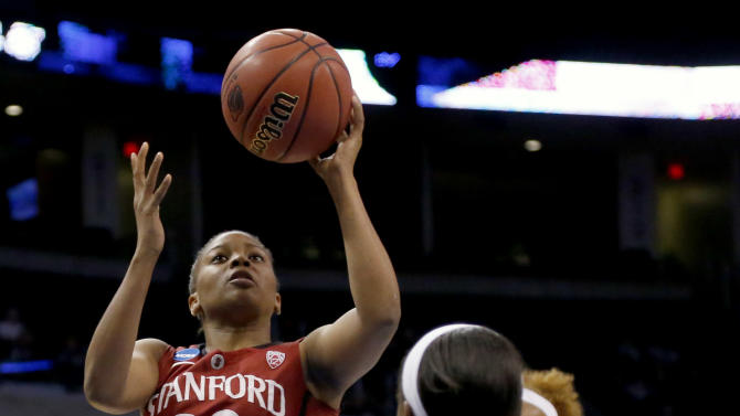 Stanford guard Amber Orrange (33) shoots over Notre Dame guard Jewell Loyd (32) during the first half of a women's college basketball regional semifinal game in the NCAA Tournament, Friday, March 27, 2015, in Oklahoma City. (AP Photo/Sue Ogrocki)