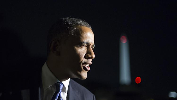 "Remarking on the vice presidential debate, President Barack Obama tells reporters, ""I think Joe Biden did great. I couldn't be prouder,"" as he returns to the White House in Washington after a day of campaign events in Miami, Thursday night, Oct. 11, 2012. (AP Photo/J. Scott Applewhite)"