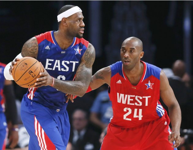 NBA All-Star James of the Heat and All-Star Bryant of the Lakers meet on the court during the NBA All-Star basketball game in Houston