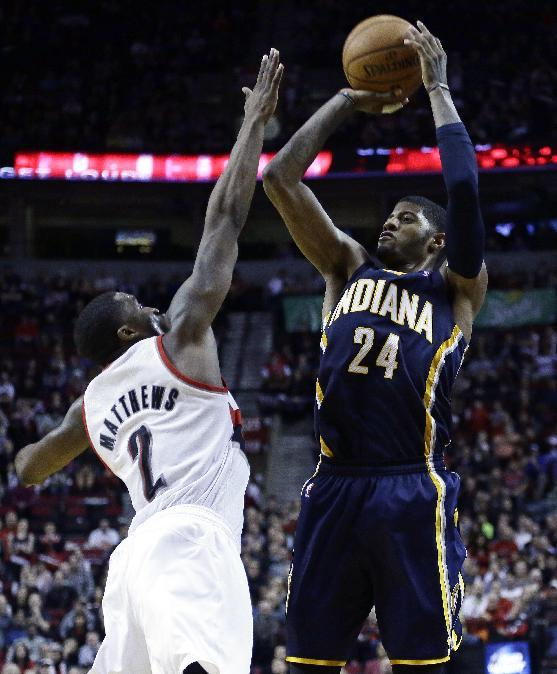 Indiana Pacers forward Paul George, right, shoots over Portland Trail Blazers guard Wesley Matthews during the second half of an NBA basketball game in Portland, Ore., Monday, Dec. 2, 2013.  George sc