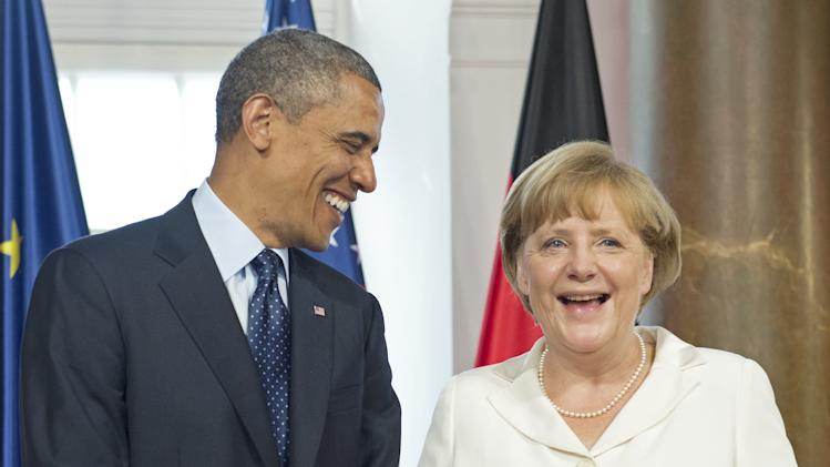 German chancellor Angela Merkel smiles besides US President Barack Obama prior their Dinner at Orangerie Charlottenburg Palace in Berlin, Germany, Wednesday, June 19, 2013. US President Barack Obama was on a two-day visit to Germany. (AP Photo/Jens Meyer)