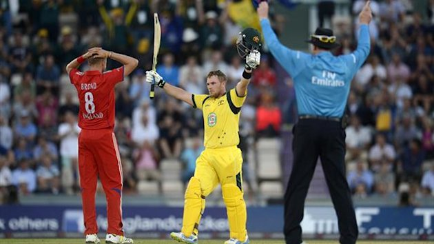 Australia's Aaron Finch celebrates after reaching his century from a six during the first T20 international against England