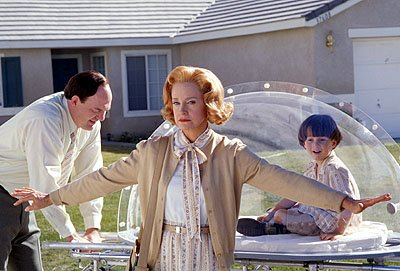 John Carroll Lynch and Swoosie Kurtz as Jimmy's parents and Mitch Holleman as Jimmy at age 4 in Touchstone's Bubble Boy