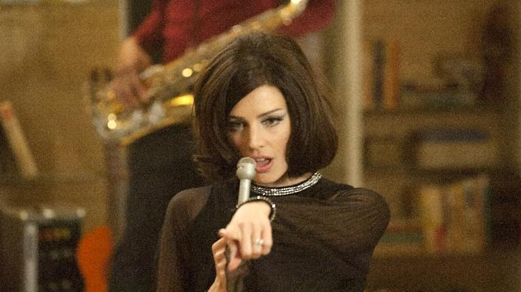 "This image released by AMC shows Jessica Pare as Megan Draper performing a French song in a scene from the season five premiere episode of ""Mad Men,"" where Megan surprises her husband Don with a birthday party.  On Thursday, July 19, 2012, the program received a total of 17 Emmy nominations including best actress in a drama series for Elisabeth Moss and best actor for Jon Hamm. The 64th annual Primetime Emmy Awards will be presented Sept. 23 at the Nokia Theatre in Los Angeles, hosted by Jimmy Kimmel and airing live on ABC. (AP Photo/AMC, Ron Jaffe)"