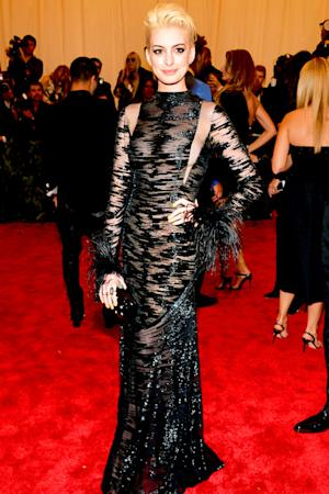 Anne Hathaway Goes Blonde, Debuts New Hair Color at Met Gala
