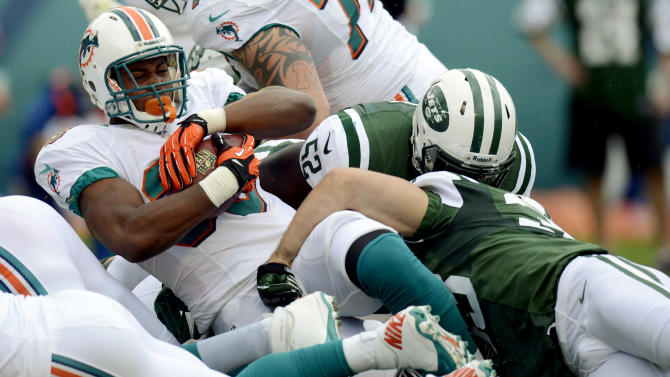 Miami Dolphins running back Daniel Thomas (33) scores a touchdown during the first half of an NFL football game against the New York Jets, Sunday, Sept. 23, 2012, in Miami. (AP Photo/Rhona Wise)