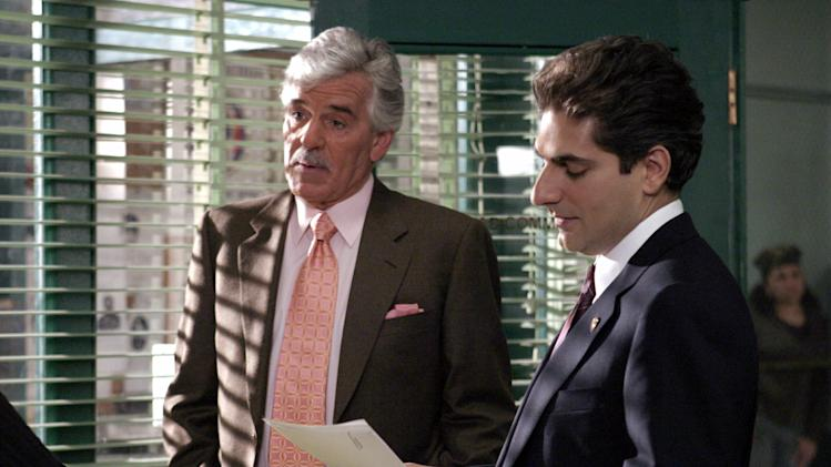 FILE - In this undated photo from NBC Universal, Dennis Farina, who plays New York Police Detective Joe Fontana, acts in a scene with Michael Imperioli in the role of Detective Nick Falco, in an episode from NBC's police drama,