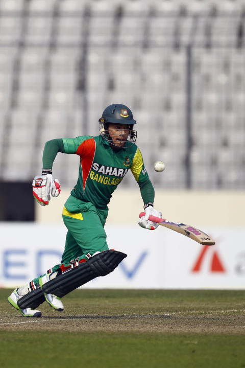 Bangladesh's Mushfiqur Rahim takes a run on the third one day international cricket against Sri Lanka in Dhaka, Bangladesh, Saturday, Feb. 22, 2014. (AP Photo/A.M. Ahad)