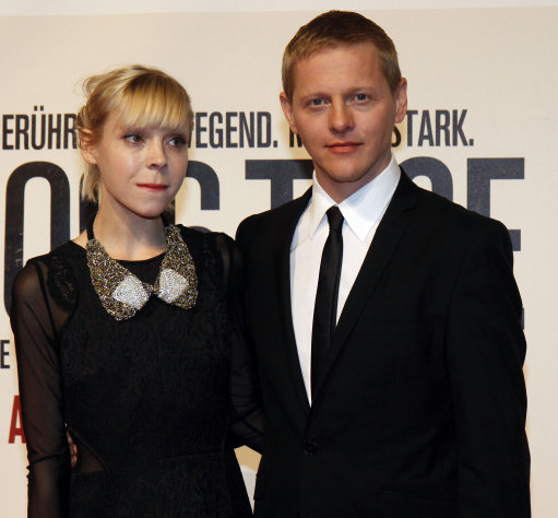 "British actress Antonia Campbell-Hughes, and Danish actor Thure Lindhardt, right, pose for photographers before the premiere of the film ""3096 Days"" in Vienna, Austria, Monday Feb. 25, 2013. The film tells the story of Natascha Kampusch who was abducted as a schoolgirl and held prisoner in a cellar for almost nine years. (AP Photo/Ronald Zak)"