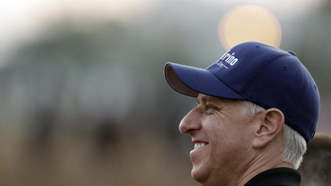 Trainer Todd Pletcher watches his Kentucky Derby entries during a morning workout at Churchill Downs Friday, May 4, 2012, in Louisville, Ky. (AP Photo/Charlie Riedel)