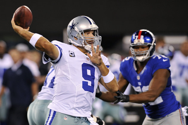 Dallas Cowboys quarterback Tony Romo (9) throws a pass during the first half of an NFL football game against the New York Giants, Wednesday, Sept. 5, 2012, in East Rutherford, N.J. (AP Photo/Bill Kost