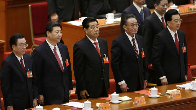 Senior party members from left, Central Commission for Discipline Inspection head He Guoqiang, Chinese Vice President Xi Jinping, People's Political Consultative Conference Chairman Jia Qinglin, National People's Congress Chairman Wu Bangguo and Chinese President Hu Jintao stand singing of the Internationale, the international communist anthem, at at the closing ceremony of the 18th Communist Party Congress held at the Great Hall of the People in Beijing Wednesday, Nov. 14, 2012. (AP Photo/Vincent Yu)