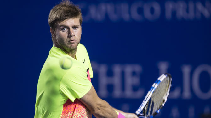 Ryan Harrison of the U.S. returns the ball to Ivo Karlovic of Croatia in a Mexican Tennis Open quarterfinal match, in Acapulco, Mexico, Thursday, Feb. 26, 2015. (AP Photo/Christian Palma)