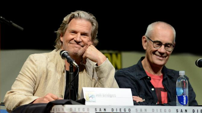 """Jeff Bridges, left, and Sergey Bodrov attend the """"Seventh Son"""" panel on Day 4 of Comic-Con International on Saturday, July 20, 2013 in San Diego. (Photo by Jordan Strauss/Invision/AP)"""