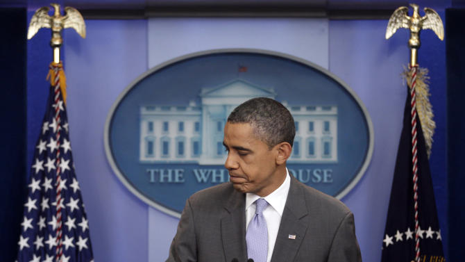 President Barack Obama turns to leave the podium after speaking from White House briefing room, Sunday, July 31, 2011 in Washington, about a deal being reached to raise the debt limit.  (AP Photo/Carolyn Kaster)