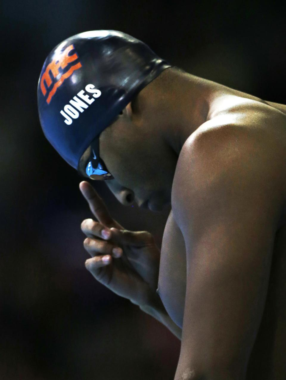 Cullen Jones prepares to swim in the men's 50-meter freestyle final at the U.S. Olympic swimming trials on Sunday, July 1, 2012, in Omaha, Neb. Jones won the final.  (AP Photo/Mark Humphrey)