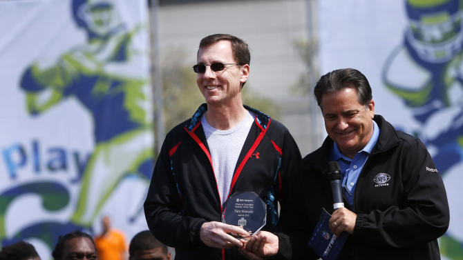 IMAGE DISTRIBUTED FOR NFL NETWORK - PE teacher Tom Winiecki, of Mott Road Elementary School in Fayetteville, N.Y., receives the NFL Network PE Teacher of the Year award from former NFL coach Steve Mariucci, right, during the NFL Play 60 Youth Football Festival, Wednesday, April 24, 2013 in New York. (Jason DeCrow/AP Images for NFL Network)