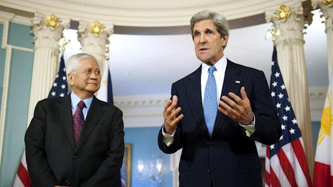 Secretary of State John Kerry, accompanied by Philippine Foreign Secretary Albert del Rosario gestures while speaking with reporters before their meeting at the State Department in Washington, Tuesday, April 2, 2013. (AP Photo/Cliff Owen)