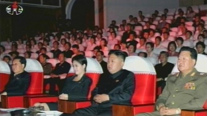 In this image made off North Korea's KRT video footage, North Korean leader Kim Jong Un, second from right, watches performances by North Korea's new Moranbong band in Pyongyang, North Korea, Friday, July 6, 2012. Mickey Mouse and Winnie the Pooh took the stage during the concert for Kim in an unusual performance featuring Disney characters in North Korea. (AP Photo/KRT)