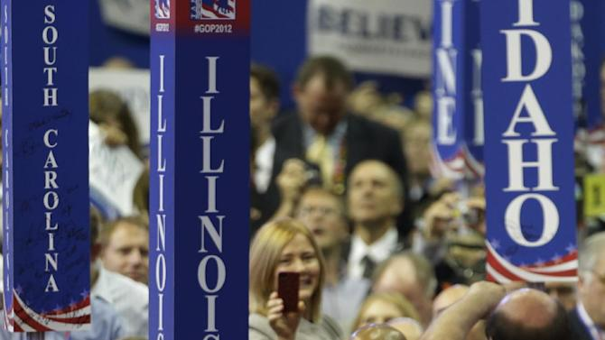 Republican presidential nominee Mitt Romney makes his way through delegates before speaking at the Republican National Convention in Tampa, Fla., on Thursday, Aug. 30, 2012. (AP Photo/Charlie Neibergall)