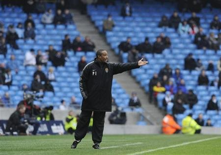Notts County's coach Ince reacts during their FA Cup soccer match against Manchester City at Manchester