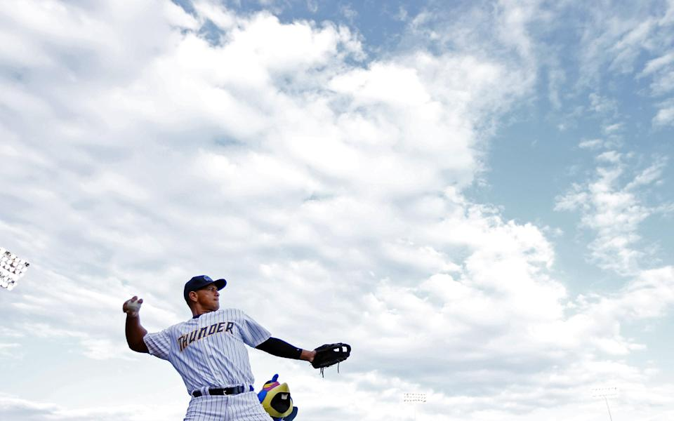New York Yankees third baseman Alex Rodriguez (13) warms upe before the start of a Class AA baseball game with the Trenton Thunder against the Reading Phillies Saturday, Aug. 3, 2013, in Trenton, N.J. (AP Photo/Rich Schultz)