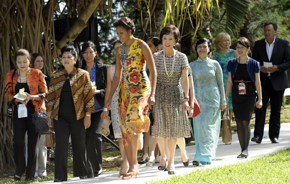 First lady Michelle Obama and other spouses of APEC leaders walk to see a performance by the Honolulu Boys Choir at the APEC Spousal Luncheon at Kualoa Ranch in Ka'a'awa, Hawaii, Sunday, Nov. 13, 2011.  (AP Photo/Susan Walsh)