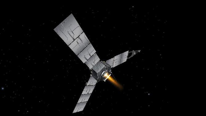 This artists rendering provided by NASA shows the Juno spacecraft during an engine burn. NASA decided to postpone a second planned burn Sept. 4, 2012 to study the spacecraft's propulsion system. The space agency said the delay will not affect the mission timeline. (AP Photo/NASA)