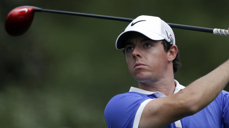 Rory McIlroy, of Northern Ireland, watches his tee shot on the 15th green during the first round of the Masters golf tournament Thursday, April 11, 2013, in Augusta, Ga. (AP Photo/David Goldman)