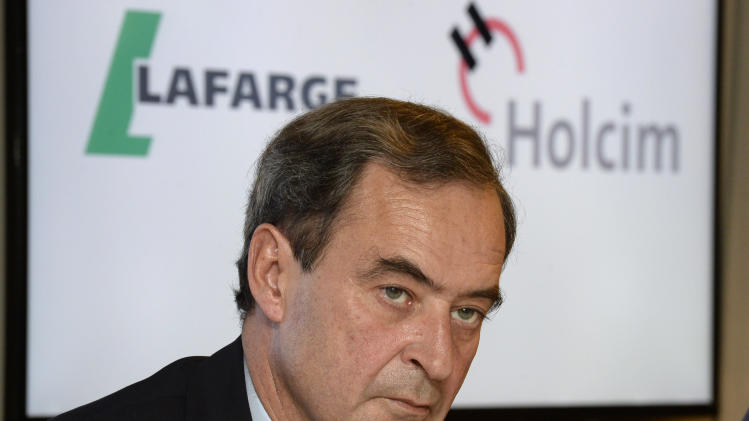 "Bruno Lafont, future chairman of LafargeHolcim speaks at a news conference in Zurich, Switzerland, Monday, April 7, 2014. Swiss-based Holcim and its French counterpart, Lafarge, two of the world's largest suppliers of building materials announced plans for a ""merger of equals"" Monday that would create an industry giant with a combined 32 billion euros (US dollar 44 billion) in annual revenues. (AP Photo/Keystone, Steffen Schmidt)"