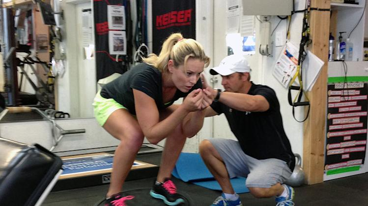 Lindsey Vonn works out with Red Bull coach Martin Hager in Vail, Colo., Wednesday Aug. 28, 2013. Vonn's surgically repaired right knee is nearly fully healed and she plans to ski this weekend. The four-time overall World Cup champion is looking at a possible return to competition in late November in Beaver Creek, Colo. That's three months ahead of the Sochi Olympics, where she will defend her downhill title. (AP Photo/Pat Graham)