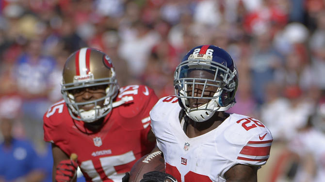 New York Giants free safety Antrel Rolle (26) returns an interception as wide receiver Michael Crabtree (15) chases during the third quarter of an NFL football game in San Francisco, Sunday, Oct. 14, 2012. (AP Photo/Mark J. Terrill)