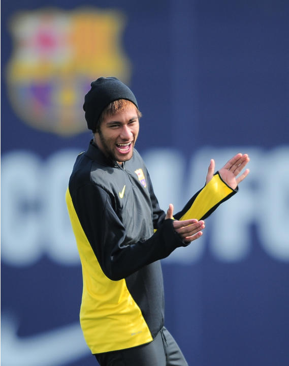 FC Barcelona's Neymar, from Brazil laughs and claps his hands during a training session at the Sports Center FC Barcelona Joan Gamper in San Joan Despi, Spain, Tuesday, March 11, 2014. FC Barcelon