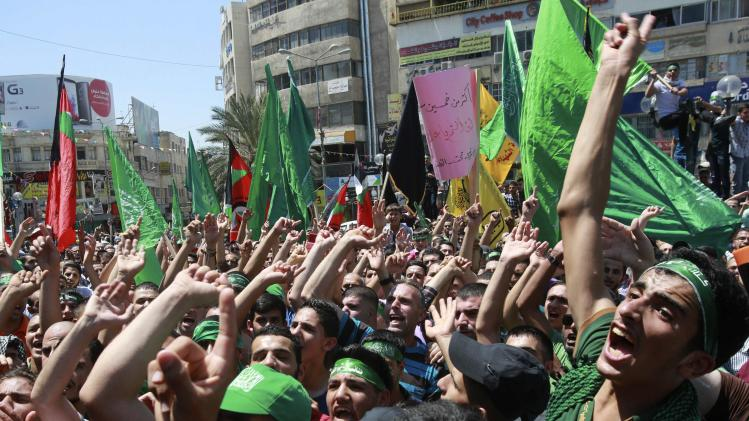 Palestinian Hamas supporters shout anti-Israel slogans during a protest against the Israeli offensive in Gaza, in the West Bank city of Nablus
