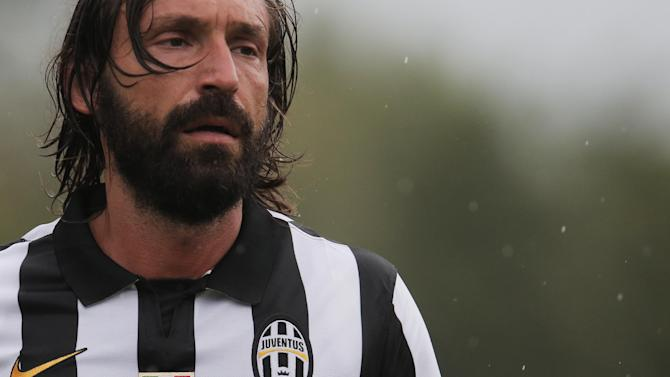 Juventus A' midfielder Andrea Pirlo looks on during a friendly football match between Juventus A and Juventus B in Villar Perosa near Turin on August 20, 2014