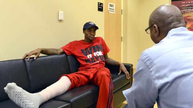 Louisville forward Kevin Ware answers questions during an interview with The Associated Press, Wednesday April 3, 2013, at the KFC Yum! Center practice facility in Louisville, Ky.  Ware was released from an Indianapolis hospital Tuesday, two days after millions watched him break his right leg on a horrifying play trying to block a shot during an NCAA college basketball regional championship game against Duke.  (AP Photo/Timothy D. Easley)