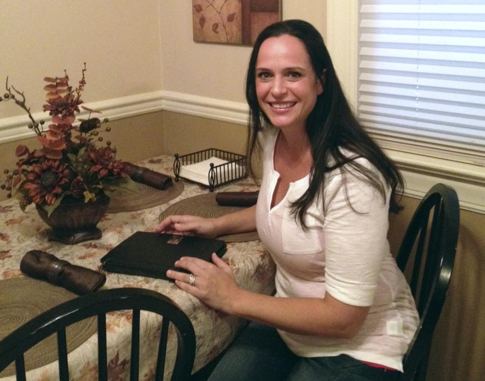 Maryann Sahoury poses for a photo at her home in Wood Ridge, N.J. on Thursday, Aug. 9, 2012. Sahoury is suing a production company after an instructional breast-feeding video she appeared in was taken by a third party and used to create pornography. (AP Photo/Katie Zezima)