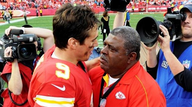 Kansas City Chiefs head coach Romeo Crennel hugs quarterback Brady Quinn after the Chiefs' win over the Carolina Panthers (Reuters)