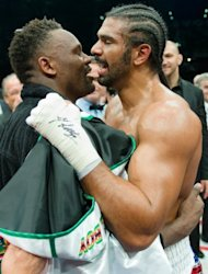 David Haye (R) hugs Dereck Chisora following their WBO International and WBA Intercontinental Heavyweight Championship fight at the West Ham football stadium in east London, on July 14. Haye won the bout in the fifth round by a knockout