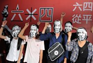 "Students wear Liu Xiaobo masks at a Tienanmen massacre commemoration in Taipei on June 4. Liu Xiaobo was jailed in 2009 for ""subversion"" after he circulated a charter calling for democratic reforms"