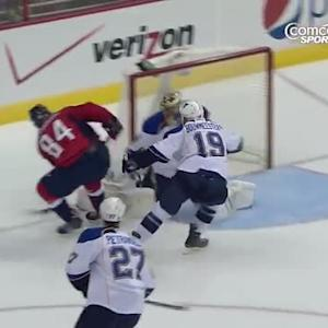 Mikhail Grabovski bats the puck past Halak