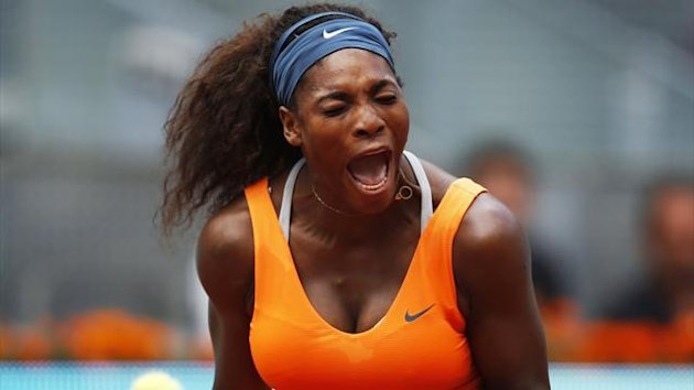 Serena Williams of the U.S. celebrates winning a point against Anabel Medina of Spain during their women's singles quarterfinal match at the Madrid Open (Reuters)