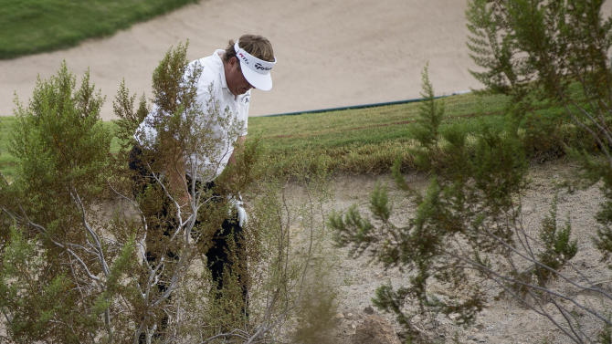 Tim Herron looks for his ball in the rough near the third green during the second round of the Justin Timberlake Shriners Hospitals for Children Open golf tournament, Friday, Oct. 5, 2012, in Las Vegas. Herron took a drop on the hole. (AP Photo/Julie Jacobson)