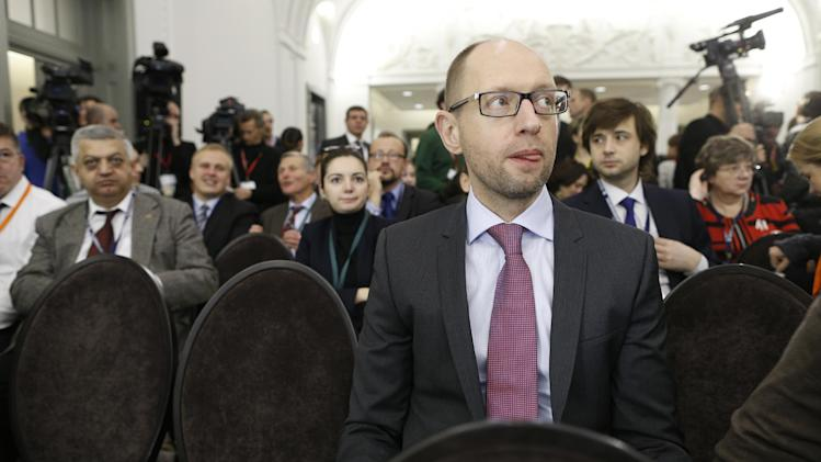 Ukrainian opposition leader Arseniy Yatsenyuk , center, waits for the start of a Civil Society Forum prior to an Eastern Partnership Summit in Vilnius on Thursday, Nov. 28, 2013. European Union leaders meet Thursday and Friday for a summit that is set to be overshadowed by a power struggle with Russia for influence in post-Soviet states. (AP Photo/Mindaugas Kulbis)