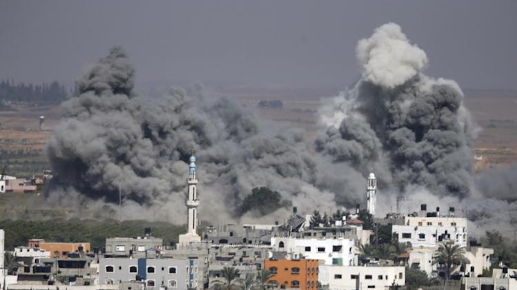 Smoke rises after an Israeli strike in Gaza City, northern Gaza Strip, Thursday, July 31, 2014. Israel said Thursday it has called up another 16,000 reservists, allowing it to potentially widen its Gaza operation against the territory's Hamas rulers in a three-week-old war that has killed more than 1,300 Palestinians and more than 50 Israelis. (AP Photo/Majed Hamdan)