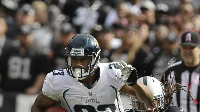 Jacksonville Jaguars running back Rashad Jennings (23) runs as Oakland Raiders linebacker Philip Wheeler (52) reaches for him during the second quarter of an NFL football game in, Sunday, Oct. 21, 2012,in Oakland, Calif. (AP Photo/Marcio Jose Sanchez)