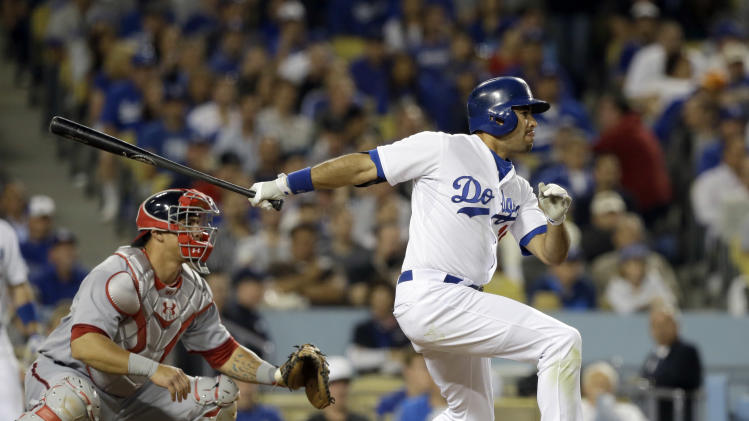 Los Angeles Dodgers' Andre Ethier connects on a two-run single, batting in Matt Kemp and Clayton Kershaw, against the Washington Nationals in the third inning of a baseball game in Los Angeles Tuesday, May 14, 2013.  Nationals catcher Wilson Ramos  is at left. (AP Photo/Reed Saxon)