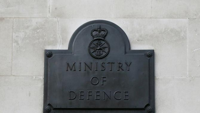 A sign hangs outside the Ministry of Defence building in London